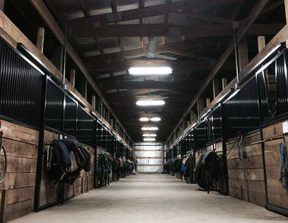 Indoor horse barn at Mechlin hunter jumper facility in St. Louis