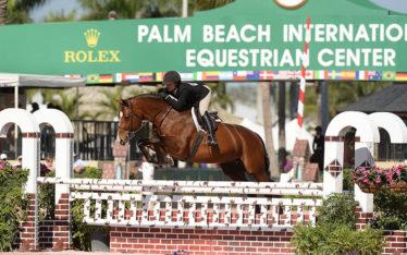 Mackenzie Altheimer jumping her horse at Palm Beach International Equestrian Center