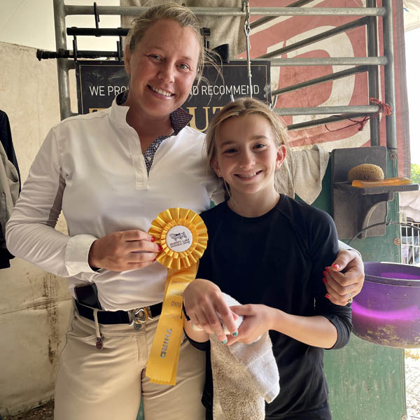 Sarah Mechlin Duhon horse trainer and riding student at horse show.