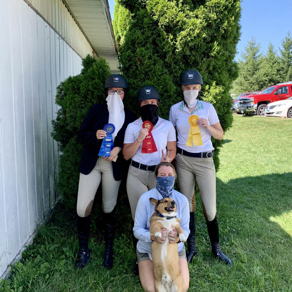 Team Mechlin showing their ribbons at the horse show.